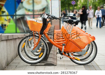 Orange city bikes for rent - stock photo