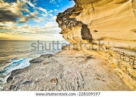 orange cliffs along the Great Ocean Road in Australia  - stock photo