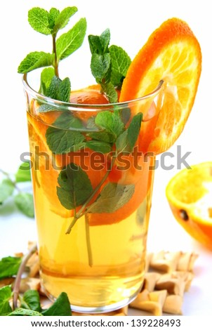 orange cocktail with mint - stock photo