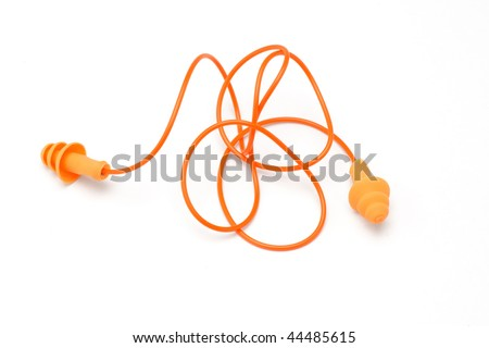 Orange color ear plugs on white background - stock photo