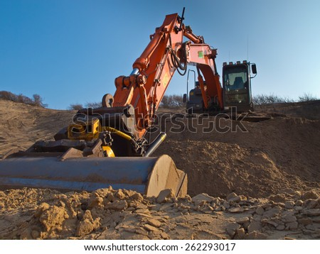 Orange colored heavy construction digger - stock photo