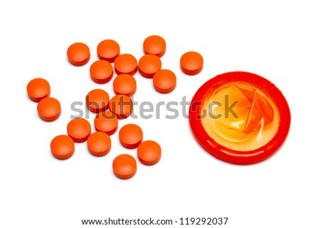 orange condom and pills isolated on white background - stock photo