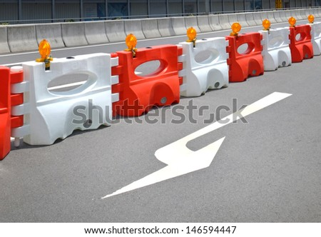 Orange construction light on barricade - stock photo