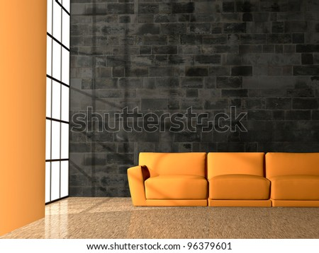 orange couch in front of a black rock wall - stock photo