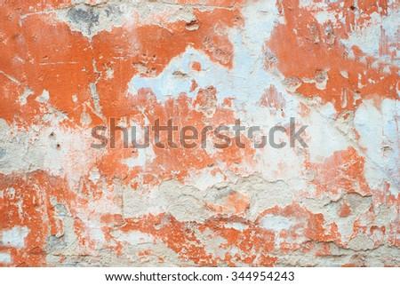 Orange cracked peeled wall surface texture background. Vintage effect.  - stock photo