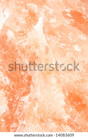 Orange cristal back ground of salt lamp - stock photo