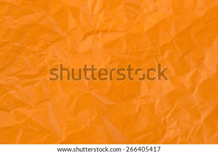 Orange crumpled paper for texture or background. - stock photo