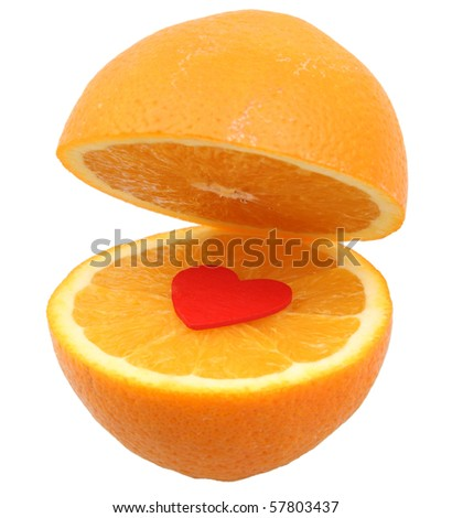 orange cut in half with red heart in the middle isolated on white with clipping path - stock photo