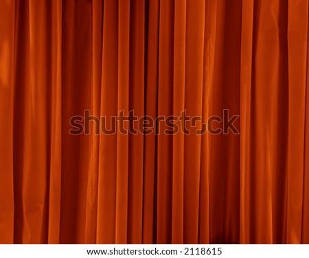 orange drapes with satin velvet light effect - stock photo