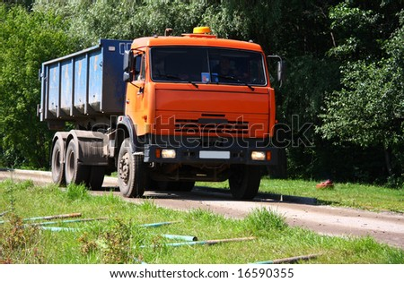 Orange dump track in city park - stock photo