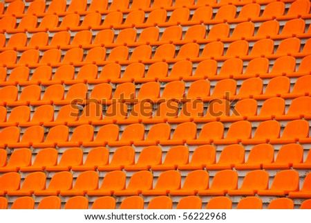 Orange empty stadium seats - stock photo