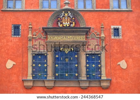 Orange facade of a medieval building from the streets of Prague Old Town, Czech Republic - stock photo