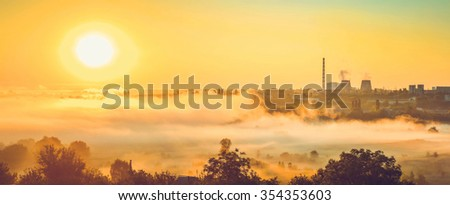 orange filter, panorama, power station and sunrise with the mist - stock photo