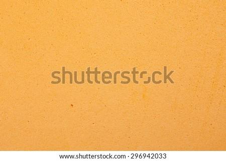 Orange foam rubber texture background. - stock photo