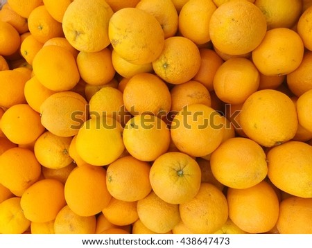 orange fruit background - pile of fresh oranges - stack of oranges   - stock photo