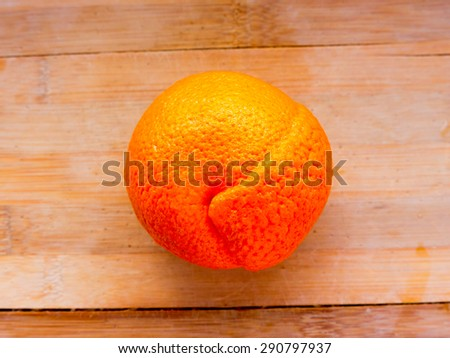 Orange fruit on a colored background. - stock photo
