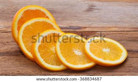 Orange fruit on wooden floor - stock photo