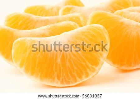 Orange fruit. Slices peeled tangerine. Mandarin section segment on white background - stock photo