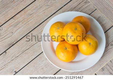 orange fruit with wood backgrounds - stock photo