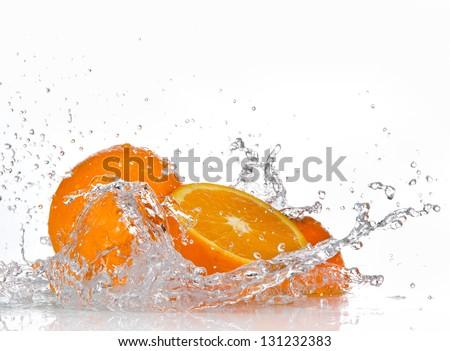 Orange fruits and Splashing water - stock photo