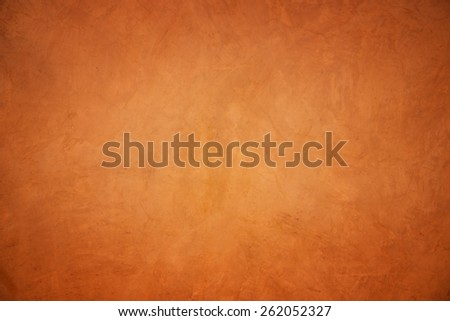 Orange grunge concrete wall textured and background. - stock photo