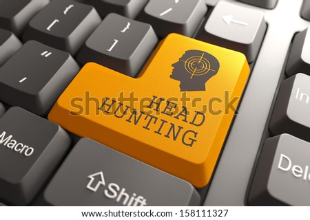 Orange Headhunting Button on Computer Keyboard. Business Concept. - stock photo