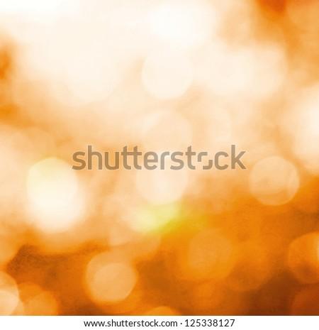 Orange holiday bokeh for background - stock photo