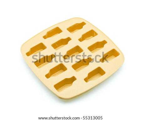 Orange ice tray isolated on white background - stock photo