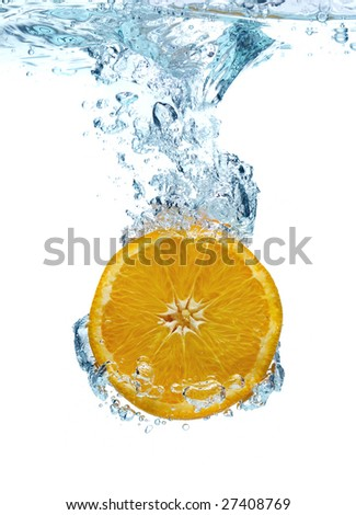 Orange in a water - stock photo