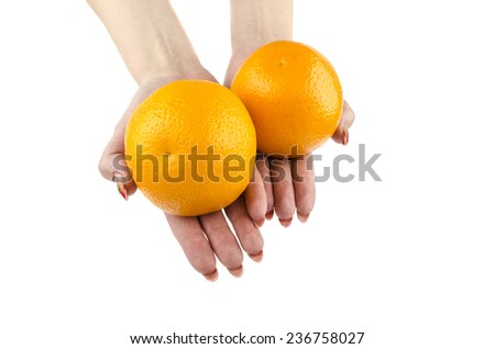 orange in hands - stock photo