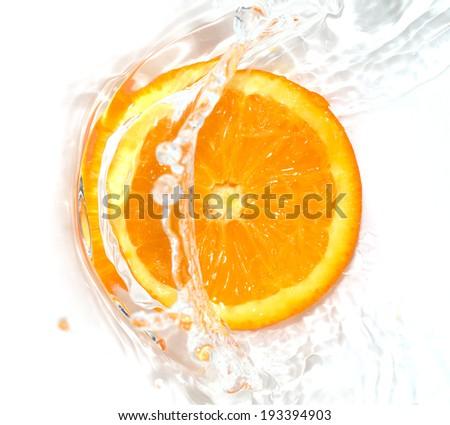 orange in water on white background - stock photo