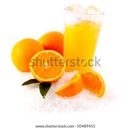 Orange Juice and Oranges on bed of ice - stock photo