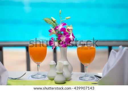orange juice fresh for drink at swiming pool - stock photo