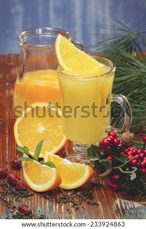 Orange juice. Fresh orange juice with orange slice for winter and Christmas. A macro photograph, shallow depth of field. Done with vintage retro filter. - stock photo