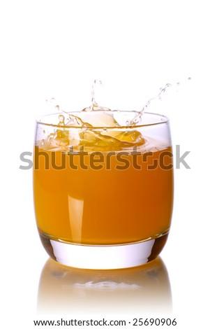 orange juice glass with splash - stock photo