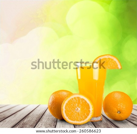 Orange juice in glass with mint,  fresh fruits on wooden background 6474 - stock photo