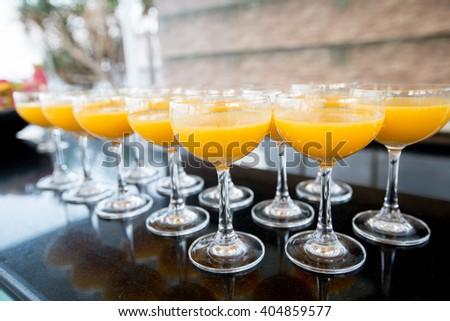 orange juice in wine glasses in the party - stock photo