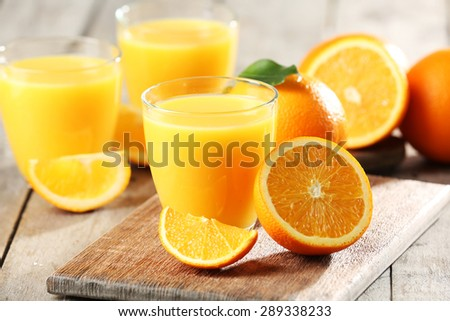 Orange juice on table close-up - stock photo