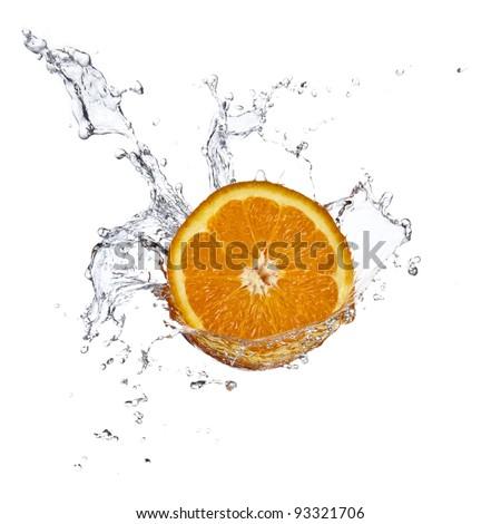 Orange juice splashing isolated on white - stock photo