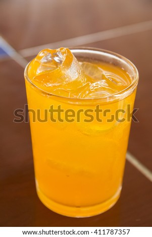 Orange juice with ice in a glass place on the table - stock photo