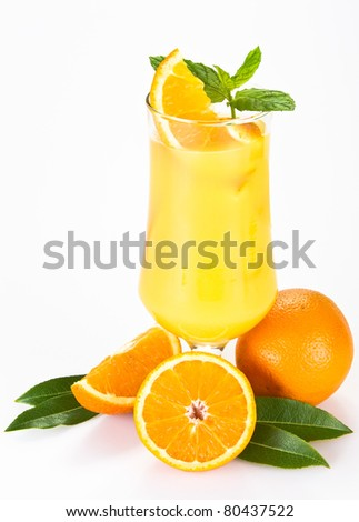 Orange juice with the pieces of orange in the glass - isolated - stock photo