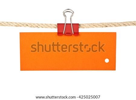 Orange label on a rope isolated on white background, closeup - stock photo
