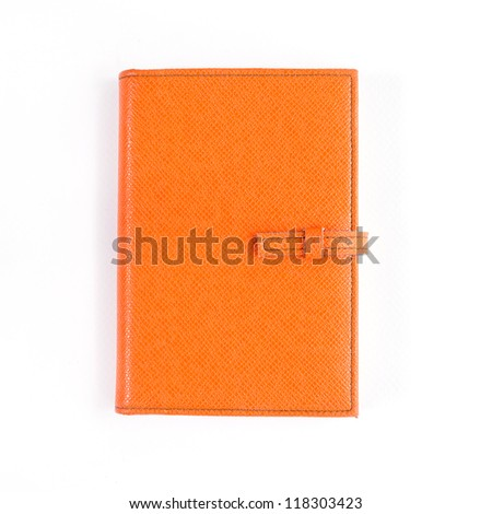 Orange leather notebook cover isolated on white background - stock photo