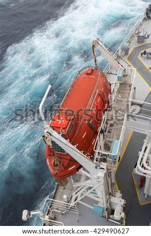 Orange lifeboat of the crude oil tanker - stock photo