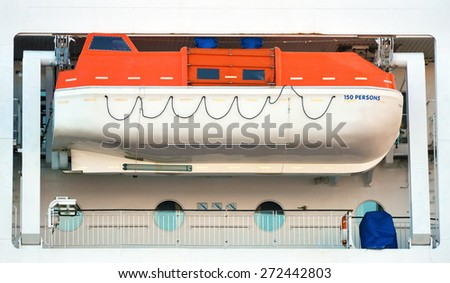 Orange lifeboat on the deck of ferry. - stock photo