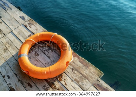 Orange lifebuoy,All Water rescue emergency equipment. - stock photo