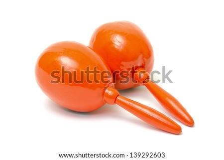 Orange maracas on white background - stock photo