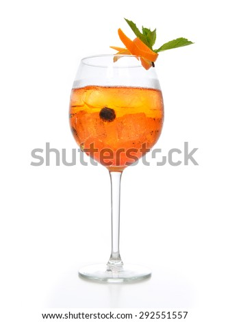 Orange margarita cocktail with fruits and vodka with crushed ice green mint in big wine glass on white background - stock photo
