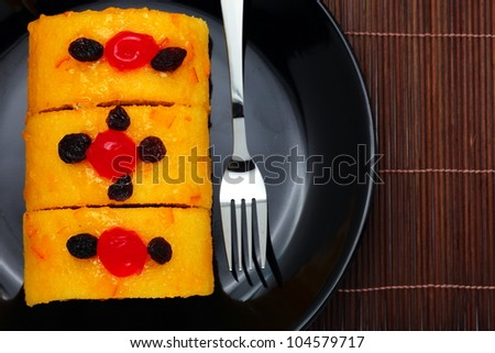 Orange marmalade cake roll. - stock photo