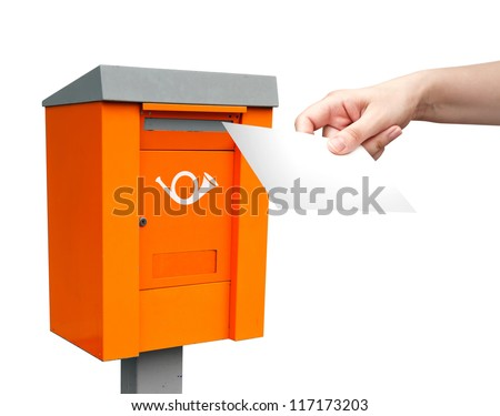 Orange metal post box and female hand with white letter - stock photo